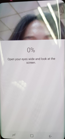Keep your eyes open fully and look at the top of the screen. Iris recognition may not work properly in direct sunlight.