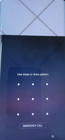 When you swipe in any direction on the locked screen, the iris recognition screen will appear.
