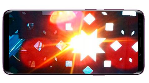 Des reflets ou des points lumineux apparaissent à côté des sources lumineuses