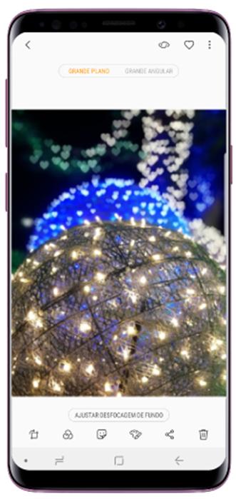 Selecione uma foto tirada com a funcionalidade Live Focus e toque em Ajustar desfocagem de fundo