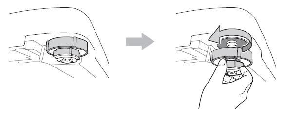 輕抬起洗衣機並將可調式支腳向左旋轉